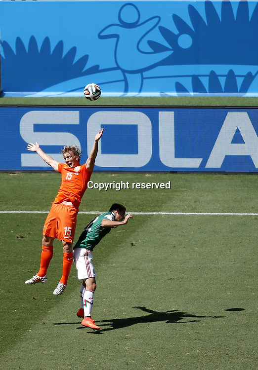 29.06.2014. Fortaleza, Brazil. Netherlands Dirk Kuyt (L) wins a header during a Round of 16 match between Netherlands and Mexico of 2014 FIFA World Cup at the Estadio Castelao Stadium in Fortaleza, Brazil, on June 29, 2014.(
