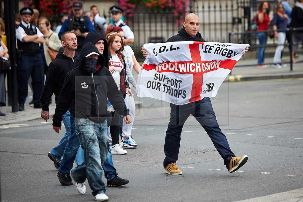 © Licensed to London News Pictures.  20/09/2014. LONDON, UK. Members of the English Defence League (EDL) march down Whitehall to Downing Street. The group is attempting to highlight it belief that  Muslim sexual grooming gangs are abusing English girls. Earlier this week a home office official warned of the rise of the far right. Photo credit: Cliff Hide/LNP