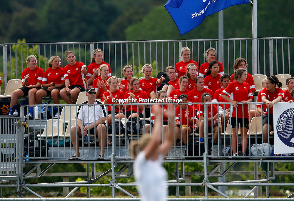 The New Zealand U17 girls team cheer on their U20 mates. OFC U-20 Women's Championship Football, Tonga v New Zealand, North Harbour Stadium Albany. Monday 25th January 2010. Photo: Shane Wenzlick/PHOTOSPORT
