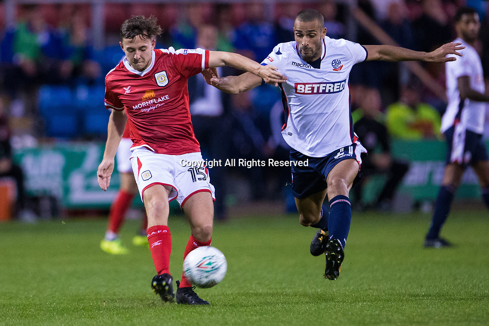 August 9th 2017, Gresty Road, Crewe, England; Carabao Cup First Round; Crewe Alexandra versus Bolton; Bolton Wanderers' Darren Pratley comes in to tackle Crewe Alexandra's Ryan Wintle