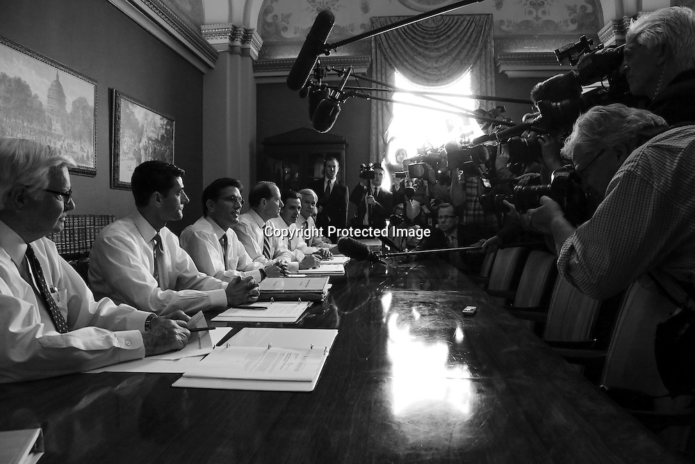 U.S. Representative Paul Ryan (R-WI) (2nd L) and House Majority Leader Eric Cantor (R-VA) (3rd L) lead a news conference with fellow members of a conference committee they proposed to the Democratic-controlled senate over the current budget impasse at the U.S. Capitol in Washington, October 1, 2013. Up to one million federal workers were thrown temporarily out of work on Tuesday as the U.S. government partially shut down for the first time in 17 years in a standoff between President Barack Obama and congressional Republicans over healthcare reforms.