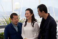 Tao Zha, Zhangke Jia, and Fan Liao at the Ash Is The Purest White (Jiang Hu Er Nv) film photo call at the 71st Cannes Film Festival, Saturday 12th May 2018, Cannes, France. Photo credit: Doreen Kennedy