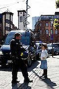Frankfurt am Main | 17.05.2012..In Frankfurt am Main sind alle geplanten Aktionen der antikapitalistischen Blockupy-Aktivisten für Mittwoch, Donnerstag und Freitag von Gerichten verboten worden, daher treffen sich am Donnerstag (17.05.2012) mehrere hundert Menschen am Hauptbahnhof Frankfurt, um von hier zur Paulskirche zu gehen und dort gegen Demo-Verbote und für Meinungsfreiheit zu demonstrieren. .Hier: Aktivisten haben Römer und Pauslplatz besetzt, hier spricht ein Polizeibeamter am Rande der Demo mit einem kleinen Mädchen...©peter-juelich.com..[No Model Release | No Property Release]