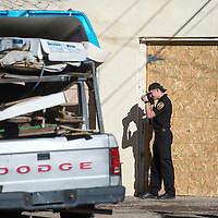 Lawrence Montoya, Investigator with the Fire Investigation Bureau based in Albuquerque, documents the scene where a man's body was discovered in the cab of a Dodge truck off South Eight Street in Gallup Wednesday.