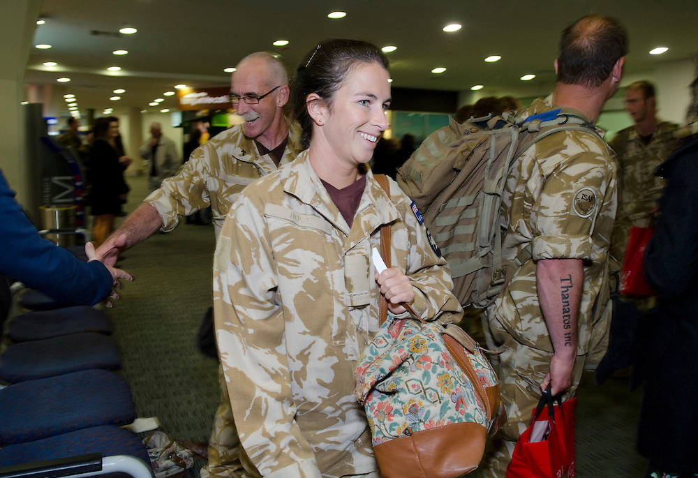 Scenes on the return of the last group of NZ Defence Force personnel who served with the New Zealand Provincial Reconstruction Team (NZPRT) in Bamyan Province, Afghanistan, at Christchurch International Airport, Christchurch, New Zealand, Saturday April 20, 2013. Credit:  SNPA / David Alexander