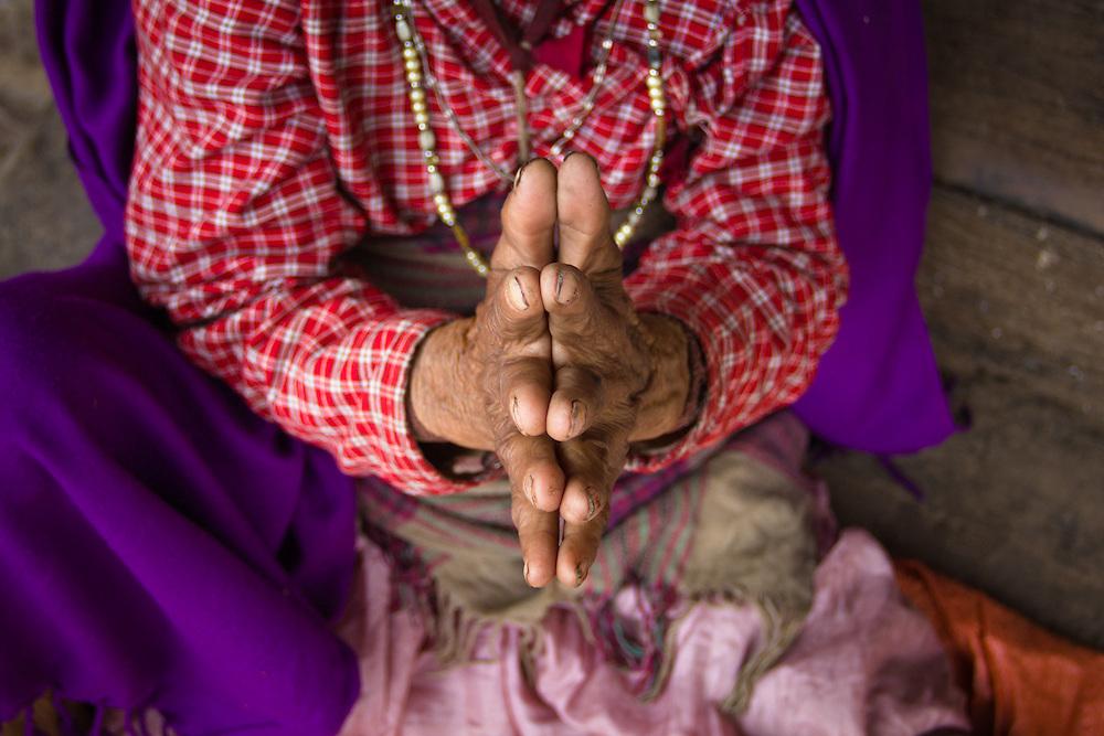 The hands of a hindu woman in Kathmandu, Nepal.