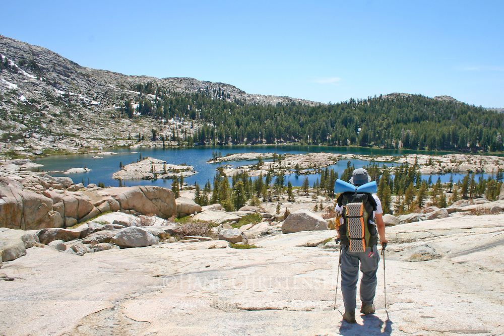 Hiker approaching Lower Penninsula Lake, Yosemite National Park