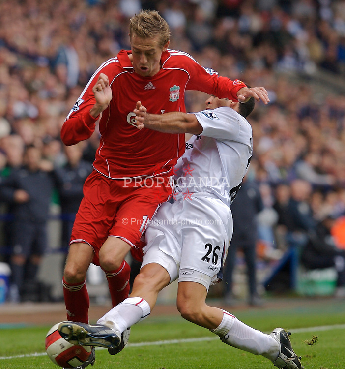 BOLTON, ENGLAND - SATURDAY, SEPTEMBER 30th , 2006: Liverpool's Peter Crouch and Bolton Wanderers' Tal Ben Haim during the Premiership match at the Reebok Stadium. (Pic by David Rawcliffe/Propaganda)