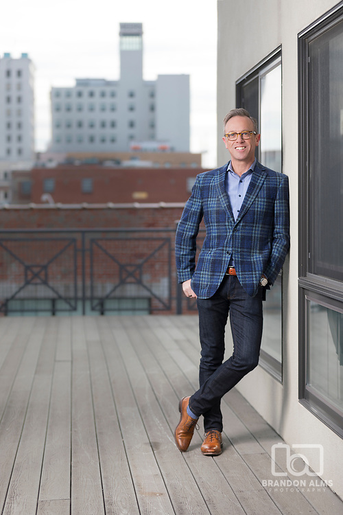 Portrait of Nathan Taylor, owner of Obelisk Home, on a rooftop. Photo by Brandon Alms Photography.
