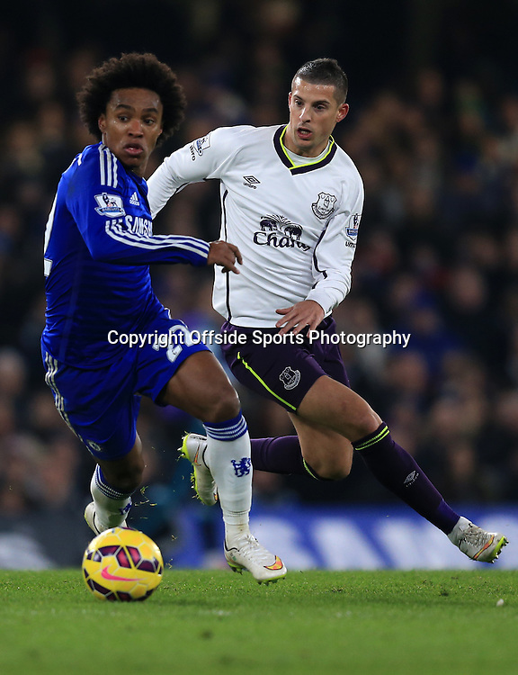 11 February 2015 - Barclays Premier League - Chelsea v Everton - Willian of Chelsea in action with Kevin Mirallas of Everton - Photo: Marc Atkins / Offside.