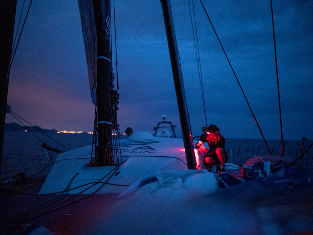 October, 2014. Leg 1 onboard Team SCA. Liz Wardley makes some notes before watch.