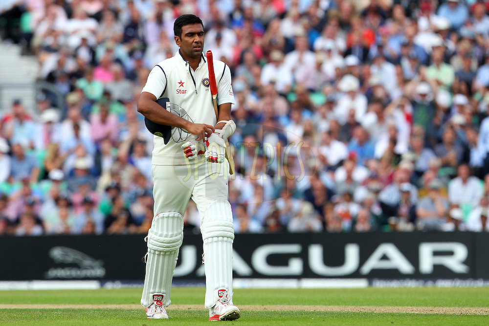 Ravichandran Ashwin of India departs during day one of the fifth Investec Test Match between England and India held at The Kia Oval cricket ground in London, England on the 15th August 2014<br /> <br /> Photo by Ron Gaunt / SPORTZPICS/ BCCI