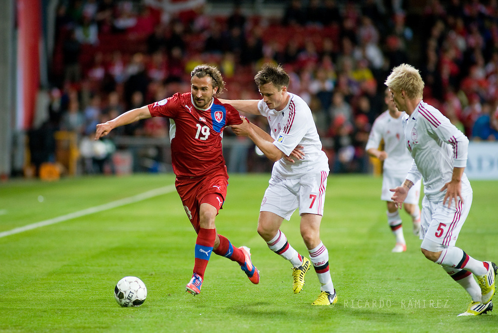 08.09.12. Copenhagen, Denmark.FIFA World Cup 2014 qualifying match Denmark 0 vs. Czech Republic 0.Czech Republic's Petr Jiracek (L) vies for the ball with Kvist Jørgensen (R) of Denmark during their World Cup 2014 qualifying soccer match at Parken Stadium in CopenhagenPhoto: © Ricardo Ramirez