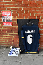 © Licensed to London News Pictures. 01/08/2018. LONDON, UK. Signs made by Julian Assange supporters outside the Ecuadorean Embassy in Knightsbridge. The UK and Ecuador are holding ongoing talks over the fate of Wikileaks founder Julian, who has been in exile in the Ecuadorean Embassy since 2012.  He faces being arrested by UK police if he leaves the embassy for breaching bail conditions.  Photo credit: Stephen Chung/LNP