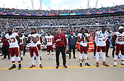 Dec 16, 2018; Jacksonville, FL, USA; Washington Redskins head coach Jay Gruden stands with his team during the national anthem an NFL game at TIAA Bank Field before playing the Jacksonville Jaguars. The Redskins beat the Jaguars 16-13. (Steve Jacobson/Image of Sport)
