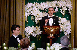 United States President Barack Obama makes remarks as Prime Minister Justin Trudeau of Canada looks on during a toast at the state dinner honoring the Prime Minister and Mrs. Sophie Grégoire Trudeau at the White House March 10, 2016 in Washington, DC. EXPA Pictures © 2016, PhotoCredit: EXPA/ Photoshot/ Olivier Douliery<br /> <br /> *****ATTENTION - for AUT, SLO, CRO, SRB, BIH, MAZ, SUI only*****