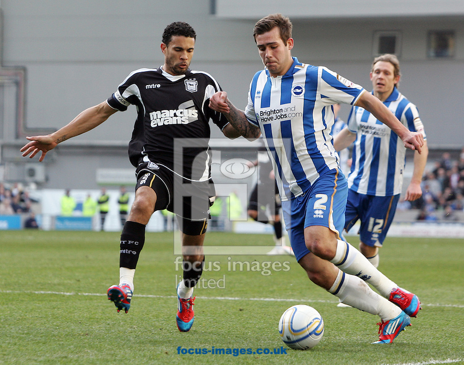 Picture by Paul Terry/Focus Images Ltd. 07545642257.25/02/12.Joe Mattock of Brighton and Hove Albion and Carlos Edwards of Ipswich Town during the Npower Championship match at The American Express Community Stadium, Brighton.