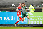 Matthew Kennedy (16) of Plymouth Argyle battles for possession with Tom Miller (23) of Carlisle United during the EFL Sky Bet League 2 match between Plymouth Argyle and Carlisle United at Home Park, Plymouth, England on 4 March 2017. Photo by Graham Hunt.