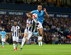 WEST BROMWICH, ENGLAND - Monday, August 10, 2015: Manchester City's captain Vincent Kompany in action against West Bromwich Albion during the Premier League match at the Hawthorns. (Pic by David Rawcliffe/Propaganda)