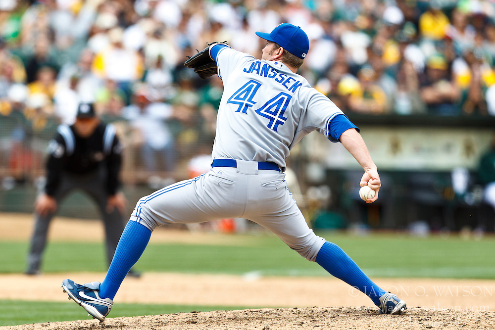 OAKLAND, CA - AUGUST 04: Casey Janssen #44 of the Toronto Blue Jays pitches against the Oakland Athletics during the ninth inning at O.co Coliseum on August 4, 2012 in Oakland, California. The Toronto Blue Jays defeated the Oakland Athletics 3-1 in eleven innings. (Photo by Jason O. Watson/Getty Images) *** Local Caption *** Casey Janssen