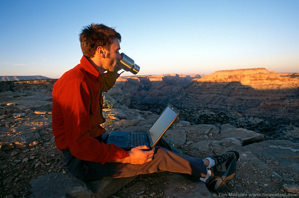 Marshall Balick works on his laptop at the Little Grand Canyon overlook in the San Rafael Swell in southern Utah.