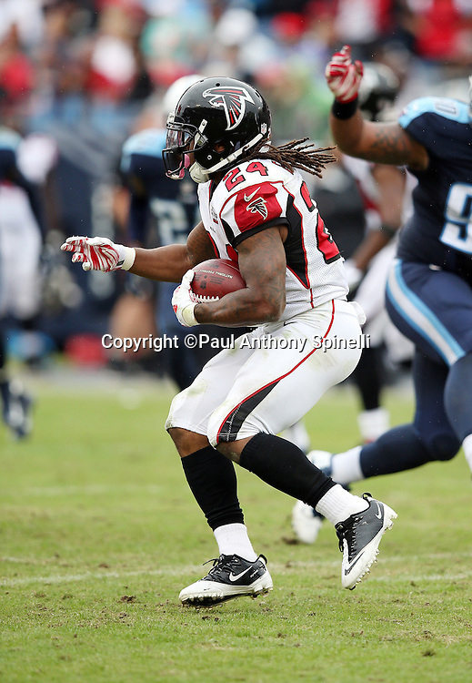 Atlanta Falcons running back Devonta Freeman (24) runs for a third quarter first down to the Tennessee Titans 45 yard line during the 2015 week 7 regular season NFL football game against the Tennessee Titans on Sunday, Oct. 25, 2015 in Nashville, Tenn. The Falcons won the game 10-7. (©Paul Anthony Spinelli)