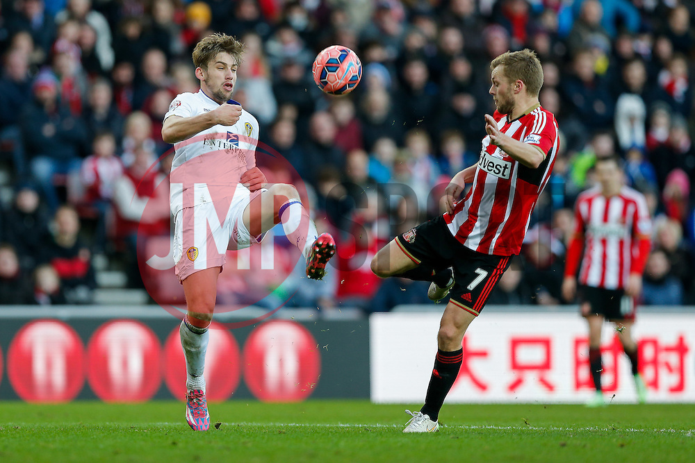 Charlie Taylor of Leeds United is challenged by Sebastian Larsson of Sunderland - Photo mandatory by-line: Rogan Thomson/JMP - 07966 386802 - 04/01/2015 - SPORT - FOOTBALL - Sunderland, England - Stadium of Light - Sunderland v Leeds United - FA Cup Third Round Proper.