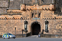 Edinburgh, Scotland, UK. 18 April 2020. Views of empty streets and members of the public outside on another Saturday during the coronavirus lockdown in Edinburgh. Police patrol outside Edinburgh Castle which is closed. Iain Masterton/Alamy Live News