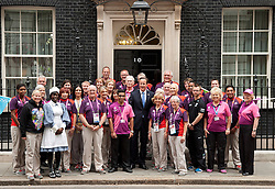 © Licensed to London News Pictures. 10/09/2012. LONDON, UK. David Cameron, the Prime Minister, is seen with Olympic and Paralympic Gamesmaker volunteers outside Number 10 Downing Street today. Photo credit: Matt Cetti-Roberts/LNP