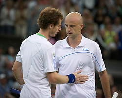 24.06.2011, Wimbledon, London, GBR, Wimbledon Tennis Championships, im Bild Andy Murray (GBR) consoles Ivan Ljubicic (CRO) after winning the Gentlemen's Singles 3rd Round match on day five of the Wimbledon Lawn Tennis Championships at the All England Lawn Tennis and Croquet Club, EXPA Pictures © 2011, PhotoCredit: EXPA/ Propaganda/ *** ATTENTION *** UK OUT!