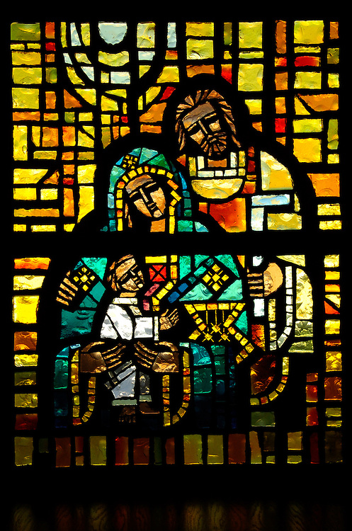 The Holy Family is depicted in this faceted glass window at St. Louis Church in Washburn.