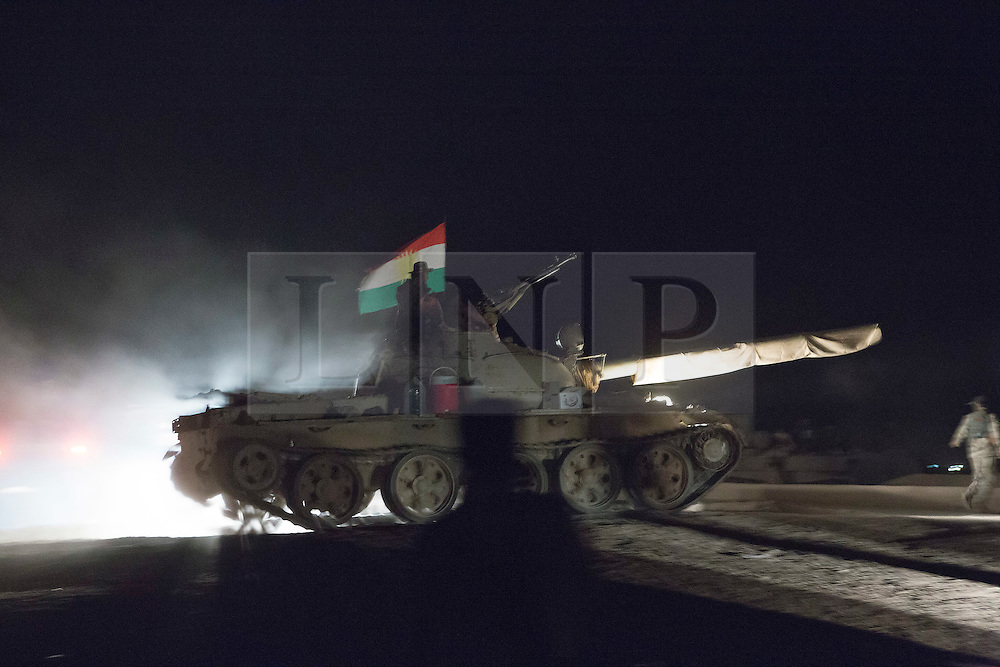 © Licensed to London News Pictures. 11/09/2015. Kirkuk, Iraq. A Kurdish peshmerga T62 tank drives in to position before the beginning of an offensive to expand a safety zone around the city of Kirkuk, Iraq.<br /> <br /> The offensive, which went unchallenged after ISIS left the area ahead of the attack, saw the peshmerga capture 15 villages along the Kirkuk front line. The objective of the offensive was to expand the safety zone around Kirkuk, stopping militants from firing missiles and rockets in to the city of Kirkuk. 3 peshmerga were killed and 24 wounded due to improvised explosive devices left behind by the militants. Photo credit: Matt Cetti-Roberts/LNP