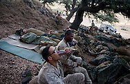 Cpl. David Jarvis eats from an MRE before the days' live-fire exercises for the 2nd Battalion, 5th Marine Regiment at Camp Pendleton.