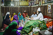 Women visit one of the current Sufi clerics to ask about their daily life issues and Islamic laws and fatwas, Delhi, India 2013