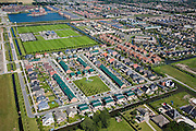 Nederland, Noord-Holland, Heerhugowaard, 14-07-2008; plandeel 1 van Stad van de Zon (Sun City), nieuwbouwwijk op VINEX lokatie, langzaam maar zeker wordt de Polder Heerhugowaard volgebouwd (richting Alkmaar), rechtsonder nog enige originele boerderijen; de wwoonwijk is ruim opgezet, met stadsvilla's, sportvelden e.d ; milieuvriendelijke wijk, energiezuinige huizen; sportveld, sportvoorziening, villa.Sun City, new housing estate in Northwest of the Netherlands, energy neutral - environmetal friendly houses, equiped with individual solar panels; suncity;  solar energy, solar panel, solar power. .luchtfoto (toeslag); aerial photo (additional fee required); .foto Siebe Swart / photo Siebe Swart