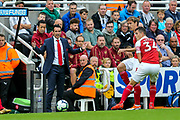 Arsenal manager Unai Emery issues instruction from the side line during the Premier League match between Newcastle United and Arsenal at St. James's Park, Newcastle, England on 15 September 2018.