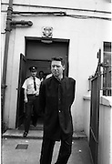 Adam Clayton on Drugs Charge. (T4)..1989..07.08.1989..08.07.1989..7th August 1989..Adam Clayton a member of the band 'U2' was remanded on bail in the Dublin District Court today. He had attended court on a drug related charge...Mr Adam Clayton is pictured leaving the District Court after he was remanded on bail in relation to a drugs charge.