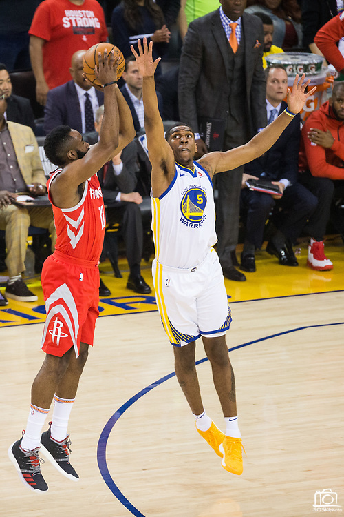 Golden State Warriors forward Kevon Looney (5) attempts to block a shot by Houston Rockets guard James Harden (13) during Game 6 of the Western Conference Finals at Oracle Arena in Oakland, Calif., on May 26, 2018. (Stan Olszewski/Special to S.F. Examiner)