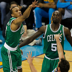 December 28, 2011; New Orleans, LA, USA; New Orleans Hornets shooting guard Marco Belinelli (8) shoots over Boston Celtics shooting guard Avery Bradley (0) during the first quarter of a game at the New Orleans Arena.   Mandatory Credit: Derick E. Hingle-US PRESSWIRE