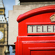 A traditional red telephone box on the foot of Westminster Bridge is in the foreground, with Elizabeth Tower (often known as Big Ben) across the Thames in the background.