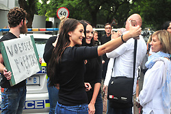 JOHANNESBURG, SOUTH AFRICA – APRIL 07: Two friends take a selfie as protestors gather outside the Gupta's Saxonwold residence call for President Zuma to step down, the Guptas through their businesses are accused of links to goverment officials and the president, in Johannesburg, South Africa, 07 April 2017. Businesses closed and South Africans from numerous political, religious, labour and civic groups gathered at central points across the entire country protesting against President Zuma's recent government reshuffle appointing 10 new ministers and 10 new deputy ministers including the axing of the finance minister. Photo: Dino Lloyd