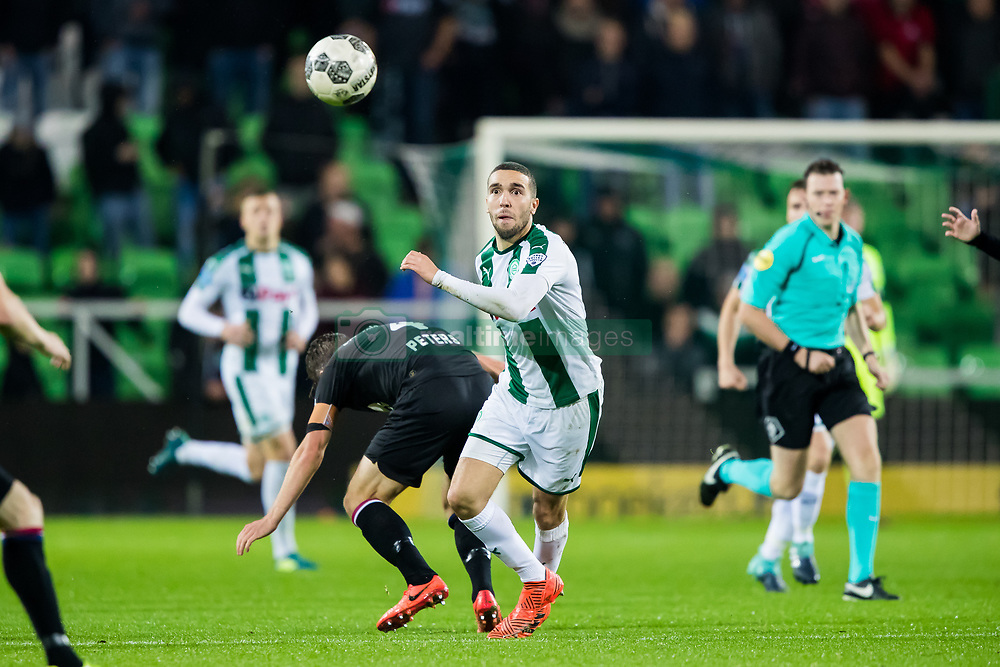 (L-R) Jordens Peters of Willem II, Mimoun Mahi of FC Groningen during the Dutch Eredivisie match between FC Groningen and Willem II Tilburg at Noordlease stadium on October 20, 2017 in Groningen, The Netherlands