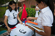 """""""Romero, Martyr of Love"""" tshirt sales are brisk at the University of San Savvador as El Salvador prepares for the beatification ceremony and mass announcing the beatification of Archbishop Oscar Romero. The Archbishop was slain at the alter of his Church of the Divine Providence by a right wing gunman in 1980. Oscar Arnulfo Romero y Galdamez became the fourth Archbishop of San Salvador, succeeding Luis Chavez, and spoke out against poverty, social injustice, assassinations and torture. Romero was assassinated while offering Mass on March 24, 1980."""