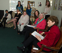 Execuative Director Kathy Keller (pink) and Child and Family Advocate Shauna Bertwell with Senator Jeanne Shaheen at New Beginnings in Laconia Friday afternoon.  (Karen Bobotas/for the Laconia Daily Sun)