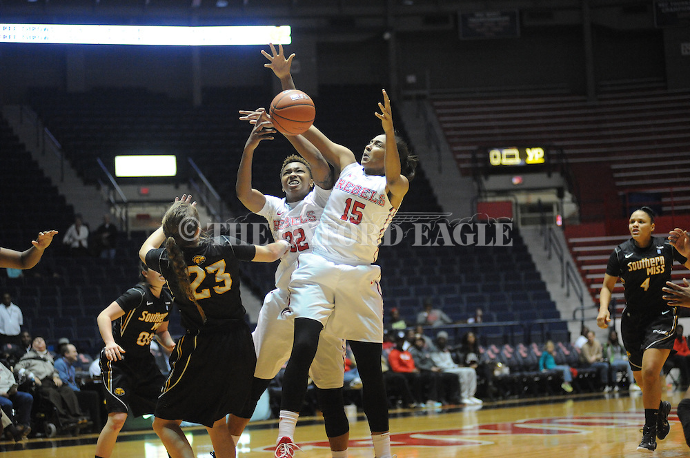 "Ole Miss Lady Rebels forward Tia Faleru (32) and Ole Miss Lady Rebels forward Kelsey Briggs (15) vs. Southern Mississippi at the C.M. ""Tad"" Smith Coliseum in Oxford, Miss. on Thursday, December 18, 2014. (AP Photo/Oxford Eagle, Bruce Newman)"