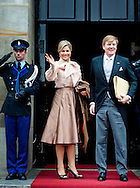 15-01-2014 Amsterdam Queen Maxima and King Willem-Alexander arrive for the New Years reception at the Royal palace in Amsterdam.  COPYRIGHT ROBIN UTRECHT