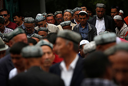 A picture made available on 31 May 2013 of Muslim men of the Uighur  ethnic group leaving the Id Kah Mosque after Friday prayers in Kashgar, western edge of China's Xinjiang Uighur Autonomous Region, China 24 May 2013. Uighurs, a Muslim ethnic minority group in China, make up about 40 per cent of the 21.8 million people in Xinjiang, a vast, ethnically divided region that borders Pakistan, Afghanistan, Kazakhstan, Kyrgyzstan and Mongolia. Other ethnic minorities living in here include the Han Chinese, Kyrgyz, Mongolian and Tajiks people. In the restive region of Kashgar, western end of Xinjiang where the North and South Silk road meets, Uighurs comprise of more than 90 per cent of the 3.9 million population. Most practice a moderate form of Islam and religion is a major part of most ordinary Uighurs' lives. Tensions have been high between the Uighurs and the dominant Han Chinese as Uighurs complain of cultural and religious repression and claim that Han Chinese migrants enjoy the main benefits of development in the oil-rich but economically backward region.