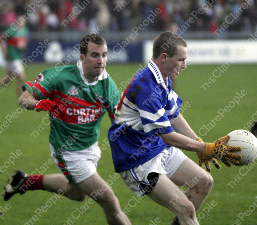 Kilkee's Noel O' Shea held his concentration despite being put under pressure by Kilmurry Ibrickane's Evan Talty during the county football final in Cusack Park on Sunday.<br />
