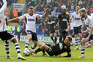 Bolton Wanderer's captain Jay Spearing challenges for the ball in the box with Wigan's Martyn Waghorn. Skybet football league championship match , Bolton Wanderers v Wigan Athletic at the Reebok stadium in Bolton on Saturday 29th March 2014.<br /> pic by David Richards, Andrew Orchard sports photography.
