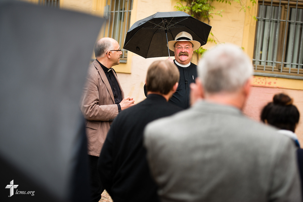 The Rev. Dr. Matthew C. Harrison, president of The Lutheran Church–Missouri Synod, leads a tour outside The International Lutheran Center at the Old Latin School in Wittenberg, Germany, on Tuesday, May 5, 2015. To the left of Harrison is Bishop Hans-Jörg Voigt of the Independent Evangelical Lutheran Church (SELK). LCMS Communications/Erik M. Lunsford